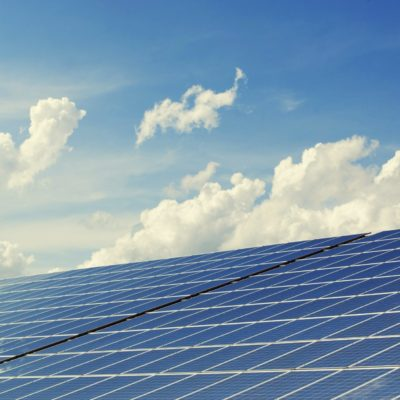 solar panels with a blue sky evoking sustainability and energy saving